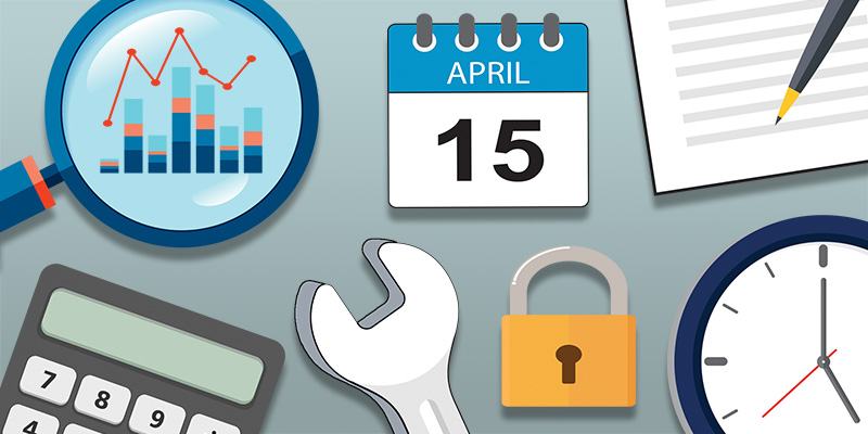 a magnifying glass, calendar set to April 15, lock, clock, wrench, and paper and pen on top of desk